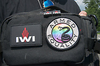 Fairfax,VA August 4 2018, USA:  This is a Gay gun group patch on a gun supporter's backpack. Demonstrators on both sides of the gun control issue rally at the National headquarters of the National Rifle Association (NRA) in Fairfax, VA.  Dubbed  &quot;The March on the NRA&quot; protestors line the streets in fron the of headquarters.  <br /> CAP/MPI/PYL<br /> &copy;PYL/MPI/Capital Pictures