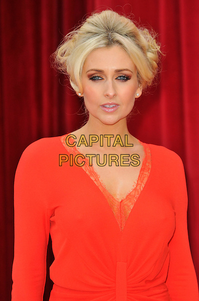 GEMMA MERNA .Attending the British Soap Awards 2011, .Granada Television Studios, Quay Street, Manchester, England, UK, .March 14th 2011..arrivals half length red long sleeve dress smiling make-up beauty hair up  v-neck lace trim .CAP/CAS.©Bob Cass/Capital Pictures.