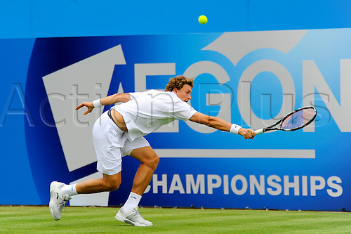 LONDON, UNITED KINGDOM, JUNE 7 2010:Dennis Istomin (UZB) returns a Jamie Baker (GBR) service during the 2010 Aegon Championships to win his opening match 6-1, 6-4, at The Queens Club, London, United Kingdom.