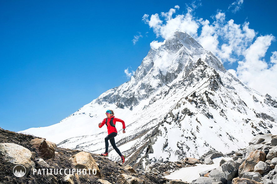 Trail running in the Indian Himalaya while on a trek to the Shivling area. The mountain Shivling is in the background.