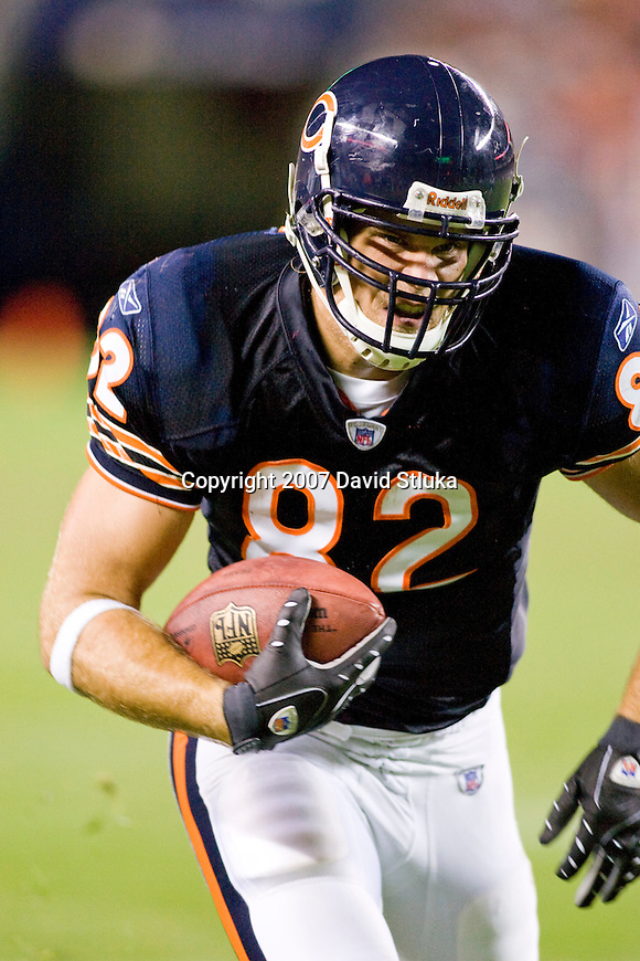 Tight end Greg Olsen #82 of the Chicago Bears gains yardage after a reception during an NFL football game against the San Francisco 49ers at Soldier Field on August 25, 2007 in Chicago, Illinois. The Bears beat the 49ers 31-13. (Photo by David Stluka)