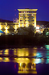 A view of the Wilma building at night from across the Clark Fork River