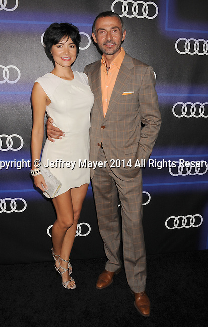 LOS ANGELES, CA- AUGUST 21: Actors Lorena Mendoza (L) and Shaun Toub arrive at the Audi Emmy Week Celebration at Cecconi's Restaurant on August 21, 2014 in Los Angeles, California.