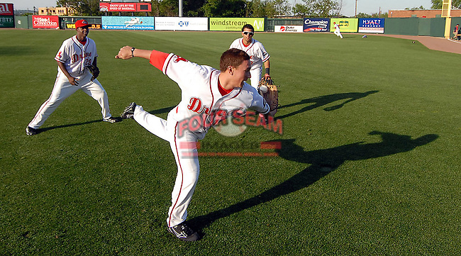 Christian Vazquez twists to grab the ball in a pepper game with Greenville Drive teammates Vladimir Frias and Kenneth Roque before a game against the West Virginia Power April 29, 2010, at Fluor Field at the West End in Greenville, S.C. Photo by: Tom Priddy/Four Seam Images