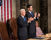 United States Vice President Mike Pence (left) and Speaker of The House of Representatives Paul Ryan (right) applaud during an address by U.S. President Donald J. Trump to a joint session of Congress on Capitol Hill in Washington, DC, February 28, 2017. <br /> Credit: Chris Kleponis / CNP