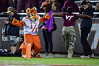 Blacksburg, VA - SEPT 30, 2017: Clemson Tigers mascot has a dance off with a Virginia Tech Hokies cadet during game between Clemson and Virginia Tech at Lane Stadium/Worsham Field Blacksburg, VA. (Photo by Phil Peters/Media Images International)