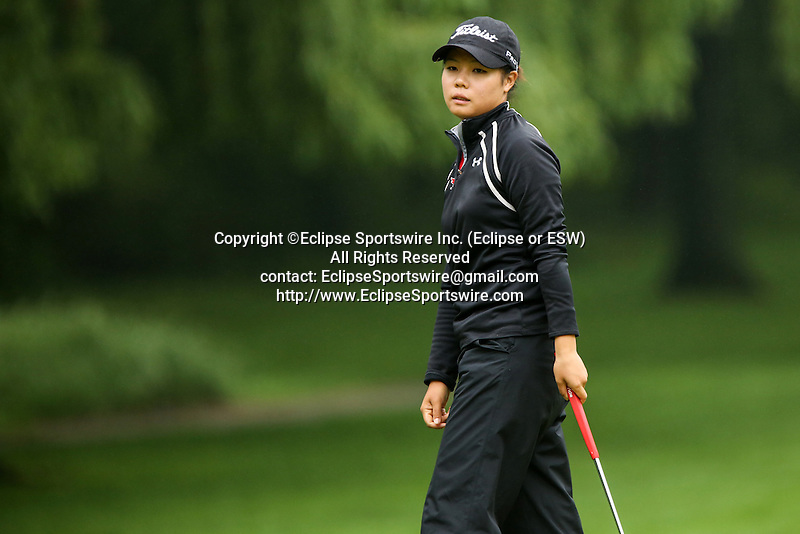 Canadian Sue Kim reacts after missing her putt on the fourth hole at the LPGA Championship at Locust Hill Country Club in Pittsford, NY on June 7, 2013