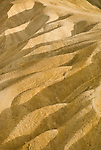 Shadows and light on the mud hills beneath Zabriski Point, Death Valley National Park, Calif.