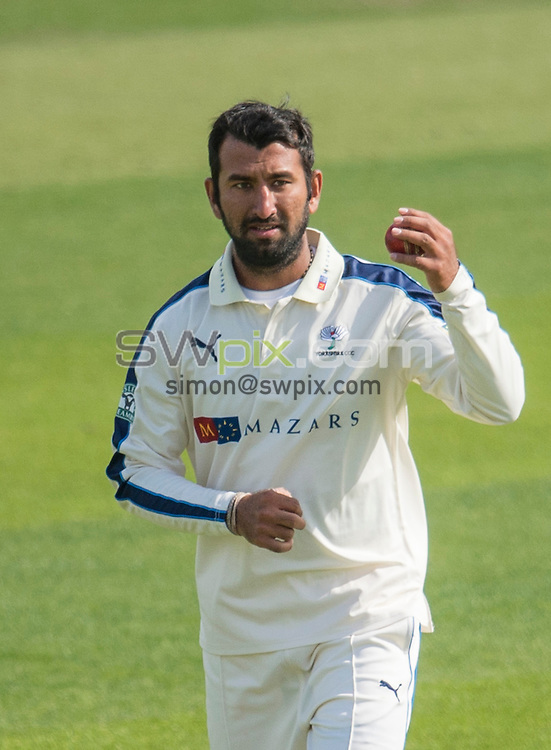 Picture by Allan McKenzie/SWpix.com - 26/04/2015 - Cricket - LV County Championship Div One - Yorkshire County Cricket Club v Warwickshire County Cricket Club - Headingley Cricket Ground, Leeds, England - Yorkshire's Cheteshwar Pujara preparing to bowl.