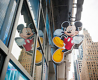 Mickey Mouse hangs out outside the Disney store in Times Square in New York on Tuesday, May 10, 2016. The Walt Disney Co. is expected to report its second-quarter earnings after the bell today. (© Richard B. Levine)