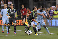 Zach Scott (20) defender Seattle Sounders holds off Kei Kamara (23) forward Sporting KC.Sporting Kansas City defeated Seattle Sounders on penalty kicks, after a 1-1 tied game to win the Lamar Hunt Open Cup at LIVESTRONG Sporting Park, Kansas City, Kansas..