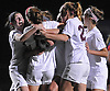 Garden City No. 14 Isabel Klatt, second from left, gets mobbed by No. 28 Julia McGuire, far left, and teammates after she scored a goal in the Nassau County varsity girls' soccer Class B final against South Side at Cold Spring Harbor High School on Tuesday, November 3, 2015. Garden City won by a score of 1-0.<br /> <br /> James Escher