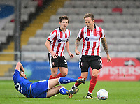 Lincoln City's Jordan Maguire-Drew vies for possession with Chesterfield's Jak McCourt<br /> <br /> Photographer Chris Vaughan/CameraSport<br /> <br /> The EFL Sky Bet League Two - Lincoln City v Chesterfield - Saturday 7th October 2017 - Sincil Bank - Lincoln<br /> <br /> World Copyright &copy; 2017 CameraSport. All rights reserved. 43 Linden Ave. Countesthorpe. Leicester. England. LE8 5PG - Tel: +44 (0) 116 277 4147 - admin@camerasport.com - www.camerasport.com