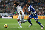 Real Madrid´s Marcelo Vieira (L) and Deportivo de la Courna´s Cavaleiro during La Liga match at Santiago Bernabeu stadium in Madrid, Spain. February 14, 2015. (ALTERPHOTOS/Victor Blanco)