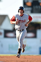 Lowell Spinners first baseman Sam Travis (40) runs the bases after hitting a home run during a game against the Batavia Muckdogs on July 16, 2014 at Dwyer Stadium in Batavia, New York.  Lowell defeated Batavia 6-4.  (Mike Janes/Four Seam Images)