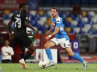 12th July 2020; Stadio San Paolo, Naples, Campania, Italy; Serie A Football, Napoli versus AC Milan;  Fabian Ruiz of Napoli passes the ball across Franck Kessie of AC Milan