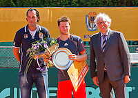 2013-08-17, Netherlands, Raalte,  TV Ramele, Tennis, NRTK 2013, National Ranking Tennis Champ,  Nick van der Meer receives the trophy from Floor Jonkers, left Floris Killian<br /> <br /> Photo: Henk Koster