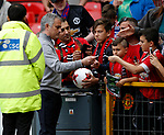 Jose Mourinho manager of Manchester United signs autographs during the English Premier League match at the Old Trafford Stadium, Manchester. Picture date: May 21st 2017. Pic credit should read: Simon Bellis/Sportimage