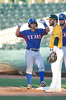 AZL Rangers Cody Freeman (33) gestures towards his team's bench after hitting a single during an Arizona League game against the AZL Athletics Gold on July 15, 2019 at Hohokam Stadium in Mesa, Arizona. The AZL Athletics Gold defeated the AZL Rangers 9-8 in 11 innings. (Zachary Lucy/Four Seam Images)