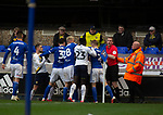 Players confronting each other in the final minute of the second-half as Ipswich Town (in blue) play Oxford United in a SkyBet League One fixture at Portman Road. Both teams were in contention for promotion as the season entered its final months. The visitors won the match 1-0 through a 44th-minute Matty Taylor goal, watched by a crowd of 19,363.