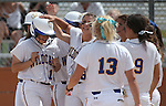 Western Nevada College's Katilyn Covione is congratulated by teammates after hitting a two-run homer against the College of Southern Nevada on Friday, May 2, 2014, in Carson City, Nev.<br /> Photo by Cathleen Allison/Nevada Photo Source