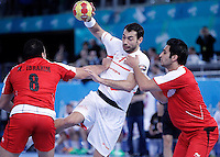 Egypt's Mohamed Ahmed (l) and Islam Hassan (r) and Spain's Daniel Sarmiento Melian during 23rd Men's Handball World Championship preliminary round match.January 14,2013. (ALTERPHOTOS/Acero) /NortePhoto