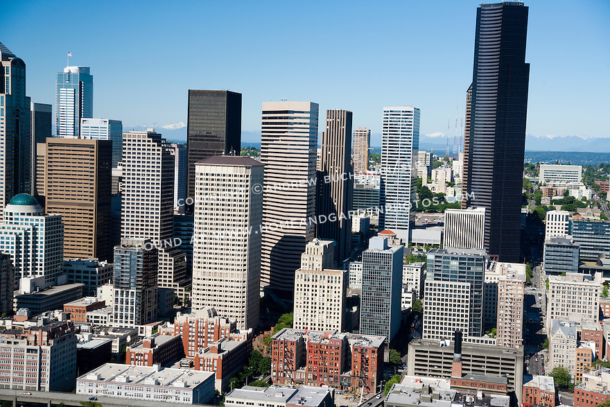 An aerial view of skyscrapers on a sunny day in downtown Seattle.