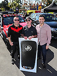Holden ambassador Greg Murphy (R) and Holden NZ Managing Director Kristian Aquilina (L) pose for a photo with major prize winner Frank Hanley. The major prize is the use of a Holden Colorado for a year.Colorado Release Street Party, Volorado Place, Avondale, Auckland, New Zealand, Saturday 10th September 2016. Photo: Simon Watts/www.bwmedia.co.nz