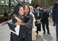 Gabbi Ncube and Melissa Donaldson. The class of 2015 graduates during Occidental College's 133rd Commencement, the Remsen Bird Hillside Theater, on Sunday, May 17, 2015.<br />