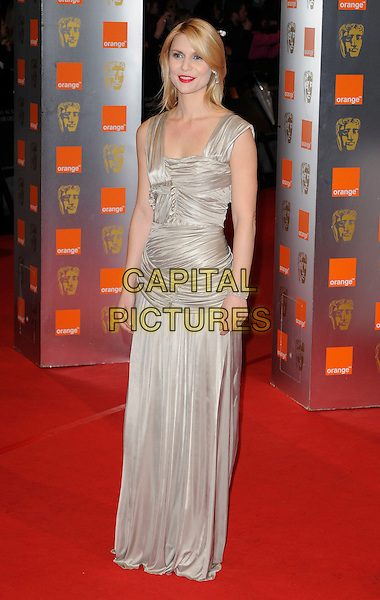 CLAIRE DANES .Arrivals at the Orange British Academy Film Awards 2010 at the Royal Opera House, Covent Garden, London, England..February 21st, 2010.BAFTA BAFTAs full length cream beige gold sleeveless ruched dress maxi bracelet clare grey gray.CAP/CAN.©Can Nguyen/Capital Pictures.