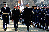 United States President Barack Obama (R) walks with French President Francois Hollande (C) for a military review during a welcoming ceremony on the South Lawn at the White House on February 11, 2014 in Washington, DC. Hollande who arrived yesterday for a three day state visit, visited Thomas Jefferson's Monticello estate and will be the guest of honor for a state dinner tonight.  <br /> Credit: Chip Somodevilla / Pool via CNP