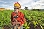 An old woman pauses from working in her farm field in Matuli, northern Malawi.