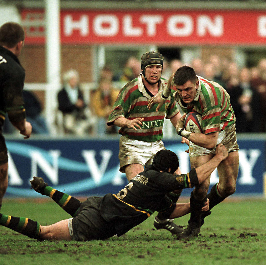 Photo. Richard Lane. .Northampton v Leicester. 13/3/99. .Martin Corry breaks the tackle of Don Mackinnson.