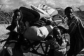 Children wait on the cart Hasan Mohamed packs all the belongings to move to the IFO extension refugee in Dadaab, world's largest refugee camp in Eastern Kenya. Photo: Sanjit Das/Panos