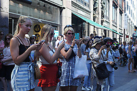 Tourists and locals photograph the Helsinki Calling peace march as it winds through central Helsinki a day ahead of the summit between US President Donald Trump and Russian President Vladimir Putin in Helsinki, Finland on July 15, 2018.