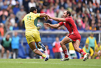 Australia's Pama Fou evades the tackle of Wales's William Harries<br /> <br /> Australia Vs Wales - Men's quarter-final<br /> <br /> Photographer Chris Vaughan/CameraSport<br /> <br /> 20th Commonwealth Games - Day 4 - Sunday 27th July 2014 - Rugby Sevens - Ibrox Stadium - Glasgow - UK<br /> <br /> © CameraSport - 43 Linden Ave. Countesthorpe. Leicester. England. LE8 5PG - Tel: +44 (0) 116 277 4147 - admin@camerasport.com - www.camerasport.com
