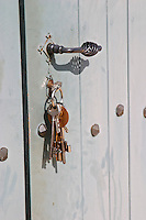 Detail of the door to the winery and a bunch of old keys Chateau Thieuley La Sauve Majeure Entre-deux-Mers Bordeaux Gironde Aquitaine France