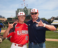 Pitcher/First Baseman Kacy Clemens #21 of Memorial High School in Texas poses for a photo with his father, former Major League pitcher Roger Clemens, before the Under Armour All-American Game powered by Baseball Factory at Wrigley Field on August 18, 2012 in Chicago, Illinois.  (Mike Janes/Four Seam Images)