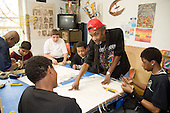Artistic Director Larry Ford with work experience pupils on placement at Flamboyan Carnival Arts