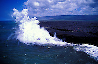 Lava from Kilauea volcano enters the sea creates clouds of steam.