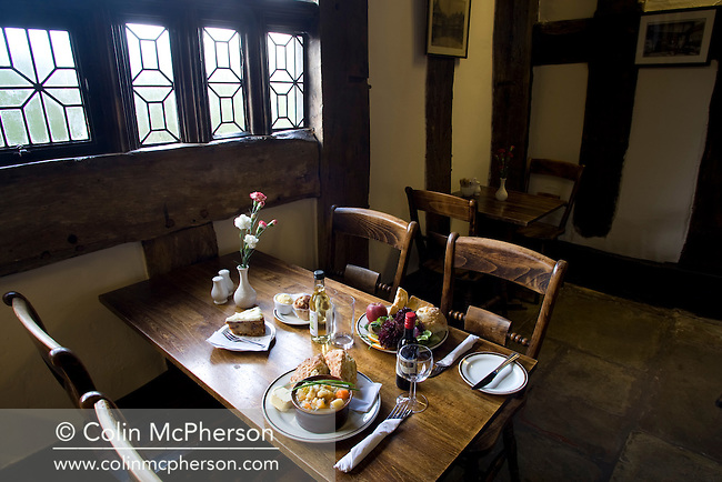 A table set with food in the restaurant at Little Morton Hall situated near the small Cheshire village of Brownlow, pictured as part of the newly-established Cheshire Food Trail. The house is run by the National Trust.