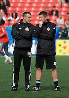 26 April 2009: Interim coach Chris Cummings,right  talks with strength & conditioning coach Paul Winsper during the warm-up at BMO Field in a game between the Kansas City Wizards and Toronto FC..Toronto FC won 1-0. .