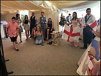 BNPS.co.uk (01202 558833)Pic: LouiseNightingale/BNPS<br /> <br /> Match of the day...<br /> <br /> A newlywed couple kept football fans at their wedding happy by showing England's game while they had their wedding breakfast.<br /> <br /> Just married Louise Nightingale and Tony Oram organised a big projector and screen in their wedding marquee to show the quarter final as they sat down for the formal dinner.<br /> <br /> Initially their 75 guests politely craned their necks to watch the action unfold from their seats but as things heated up everyone crowded round the screen to see England romp to victory.<br /> <br /> The couple said they were inundated ahead of the game with requests from friends and family to find a way of making the game available at their reception.