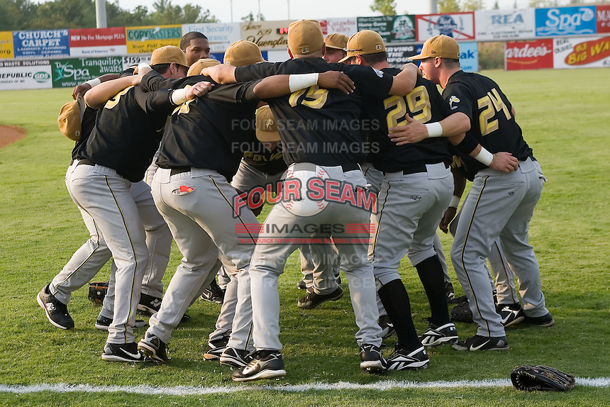 The West Virginia Power huddle up prior to taking on the Hickory Crawdads at L.P. Frans Stadium in Hickory, NC, Friday, August 24, 2007.