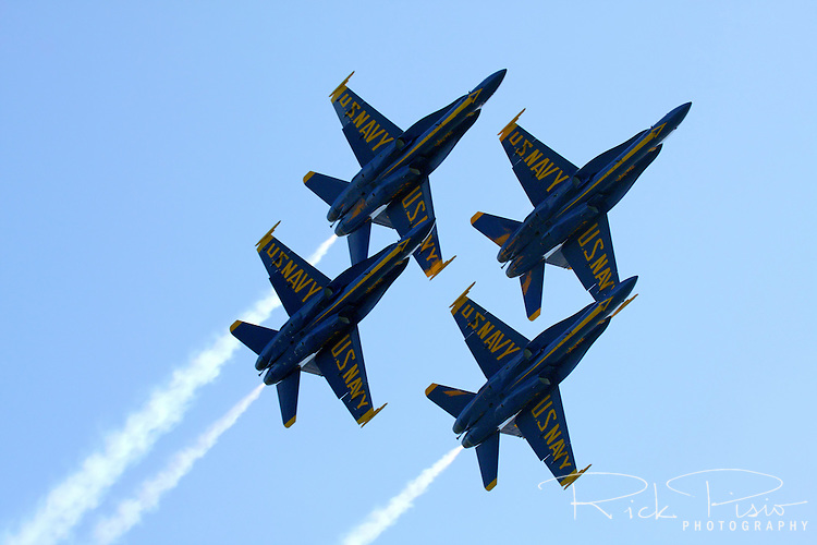 The Blue Angels in diamond formation pass overhead during 2009 San Francisco Fleet Week activities. The U.S. Navy Blue Angel's fly the Boeing built F/A-18 Hornet.