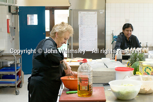 Dinner ladies preparing school lunches, State Secondary Roman Catholic school.