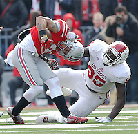 Ohio State Buckeyes wide receiver Devin Smith (9) gets brought down by Indiana Hoosiers defensive tackle Bobby Richardson (95) in the third quarter at Ohio Stadium Nov. 22, 2014.(Dispatch photo by Eric Albrecht)