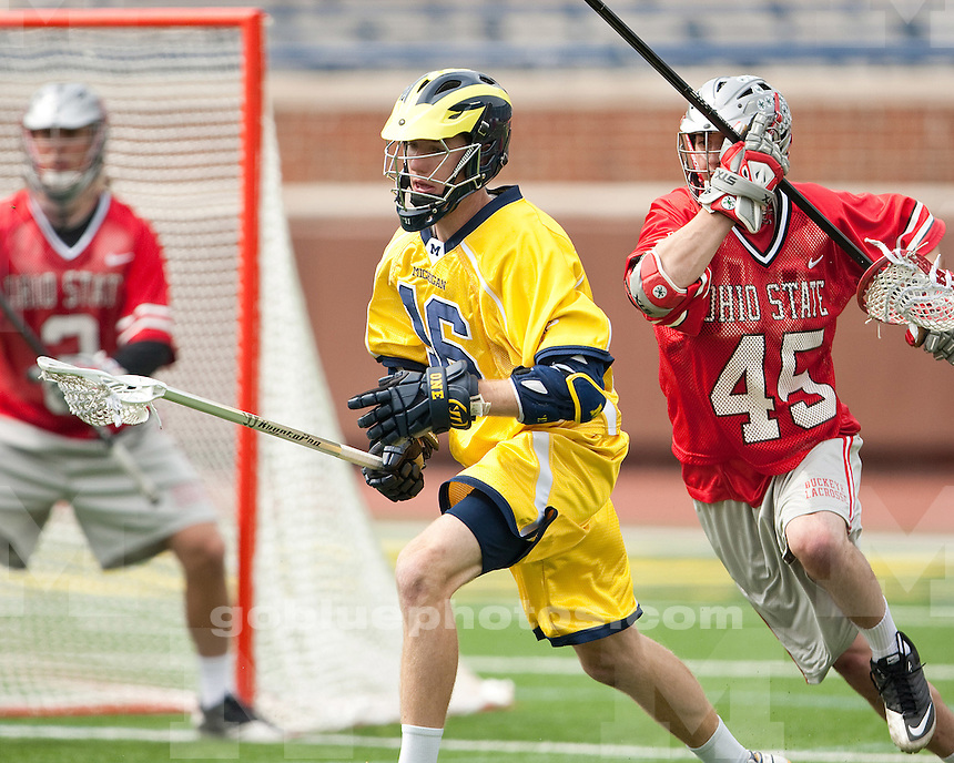 "The University of Michigan men's lacrosse team lost to Ohio State, 9-12, in the ""Battle at the Big House"" at Michigan Stadium in Ann Arbor, Mich., on April 14, 2012."