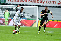 Thursday  03 October  2013  Pictured:Jonathan de Guzman gets the ball past Stephane Nater of St.Gallen<br /> Re:UEFA Europa League, Swansea City FC vs FC St.Gallen,  at the Liberty Staduim Swansea
