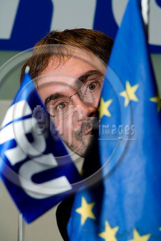 BRUSSELS - BELGIUM - 30 JANUARY 2008 -- Michael NIELSEN, General Delegate at IRU (International Road Transport Union) Permanent Delegation to the EU, hidden behind the EU flag and the IRU flag..       Photo: Erik Luntang/EUP-IMAGES/